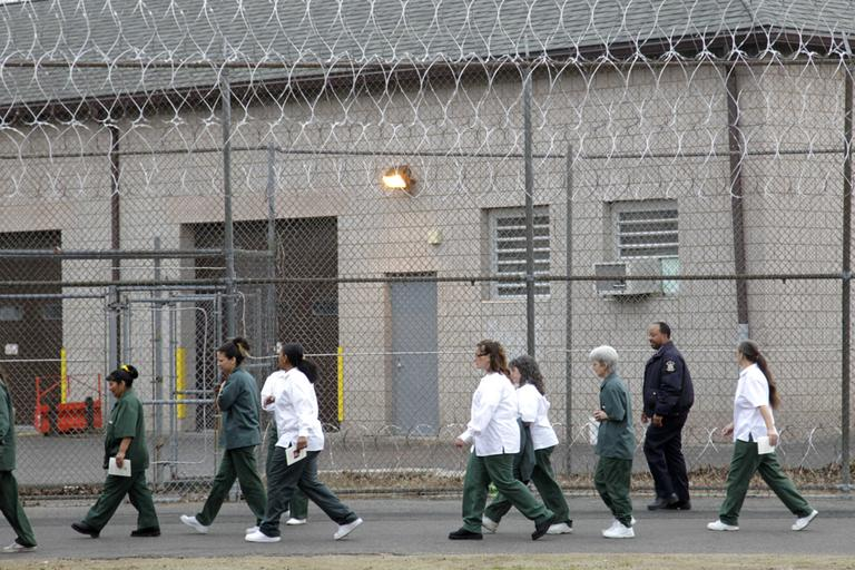 Women walk on a road at the women-only Taconic Correctional Facility in Bedford Hills, N.Y., Wednesday, March 28, 2012. (Seth Wenig/AP)