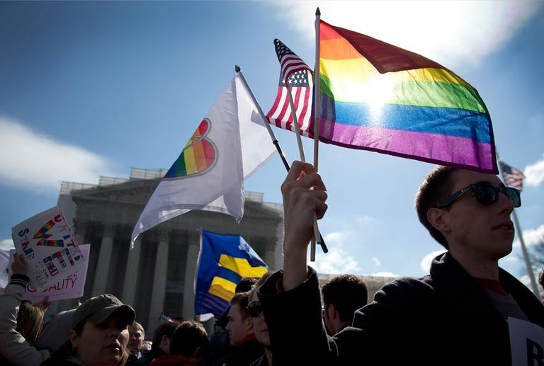 Demonstrators in front of the Supreme Court in Washington, Wednesday, March 27, 2013. (AP)
