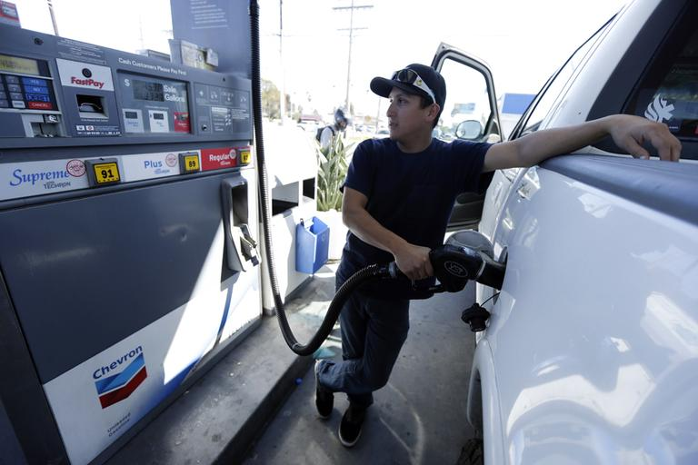 Chris King fills up his truck at a gas station in San Diego, in February 2013. (Gregory Bull/AP)