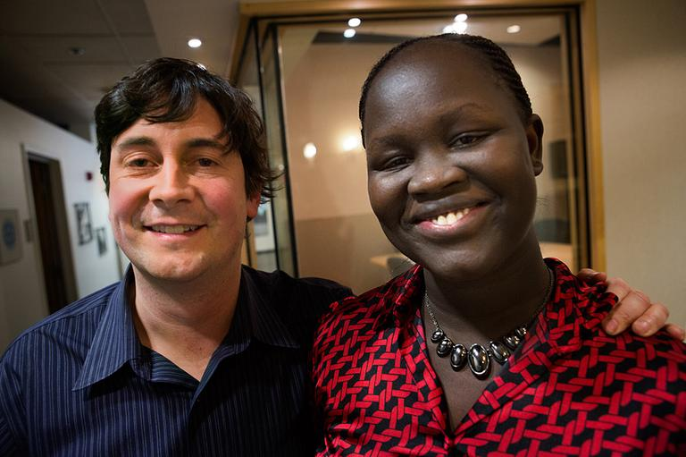 "Sasha Chanoff (left), founder and executive director of Refuge Point, and Yar Ayuel, one of 89 Sudanese girls who came to the United States along with the ""Lost Boys of Sudan,"" are pictured at the Here & Now studios. (Jesse Costa/WBUR)"