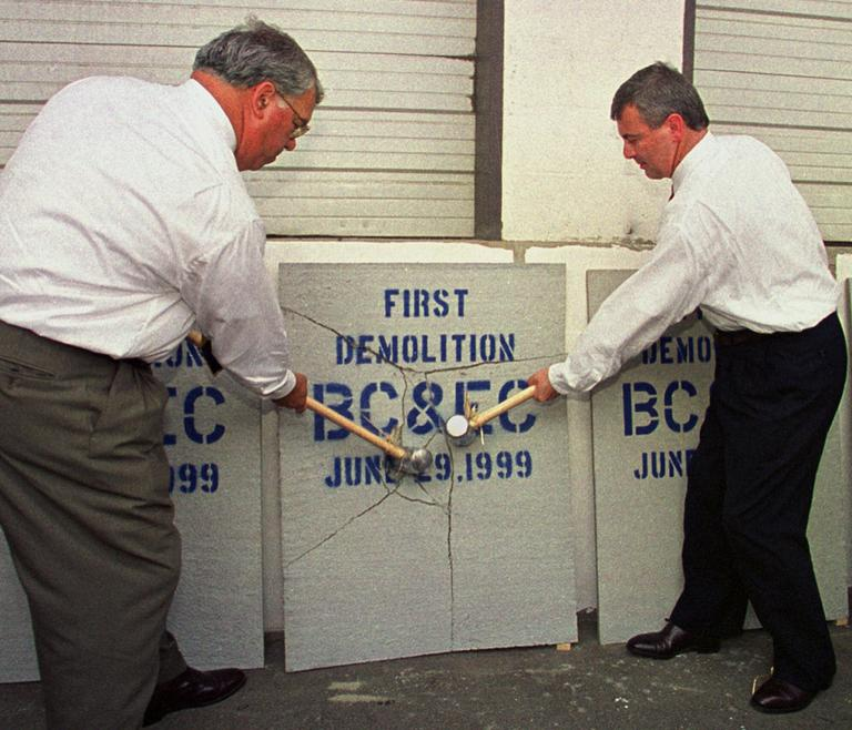 Menino, left, and then-Mass. Gov. Paul Cellucci marked the first step toward construction of the Boston Convention & Exhibition Center project site in Boston on June 29, 1999. (Gail Oskin/AP)