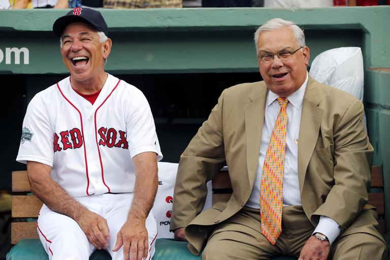 Mayor Menino jokes with former Boston Red Sox manager Bobby Valentine before a baseball game in July 2012. (Michael Dwyer/AP)