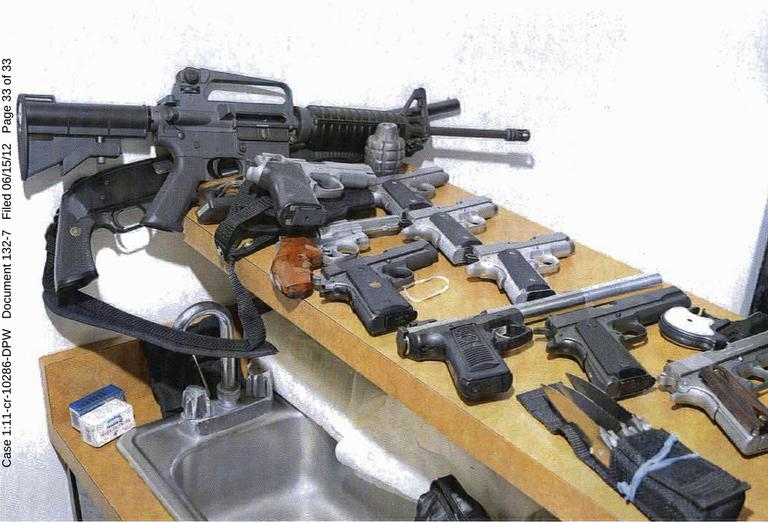 This 2011 photo provided by the U.S. Attorney's office shows guns displayed in the Santa Monica, Calif., apartment where Whitey Bulger and Catherine Greig hid before their arrest in June 2011. (U.S. Attorney's Office/AP)