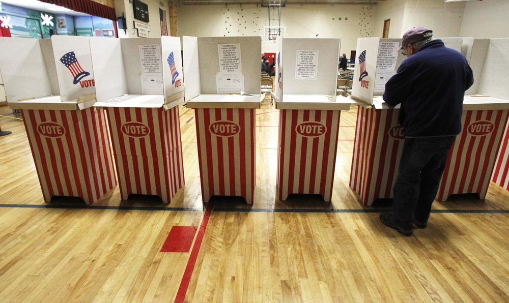 A voter casts his ballot on Tuesday, March 5, 2013 in Hardwick, Vt. (Toby Talbot/AP)