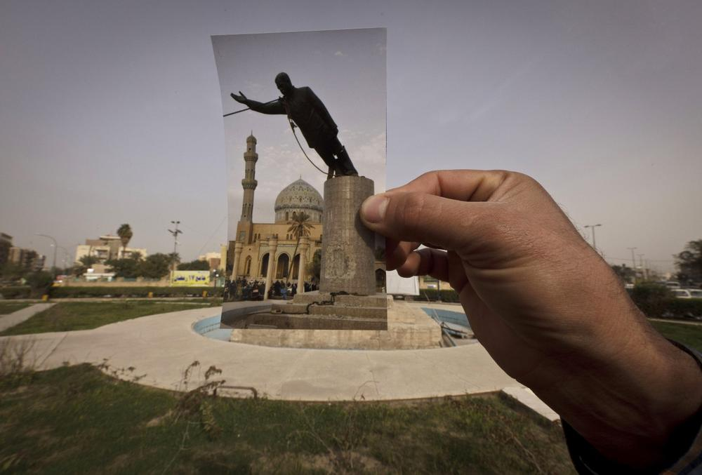 This March 13 photo shows a general view of Firdous Square at the site of an Associated Press photograph taken by Jerome Delay as the statue of Saddam Hussein is pulled down by U.S. forces and Iraqis on April 9, 2003. (Maya Alleruzzo/AP)
