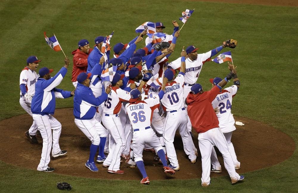 The Dominican Republic players celebrate after beating Puerto Rico in the championship game of the World Baseball Classic in San Francisco Tuesday. The Dominican Republic won 3-0. (Jeff Chiu/AP)
