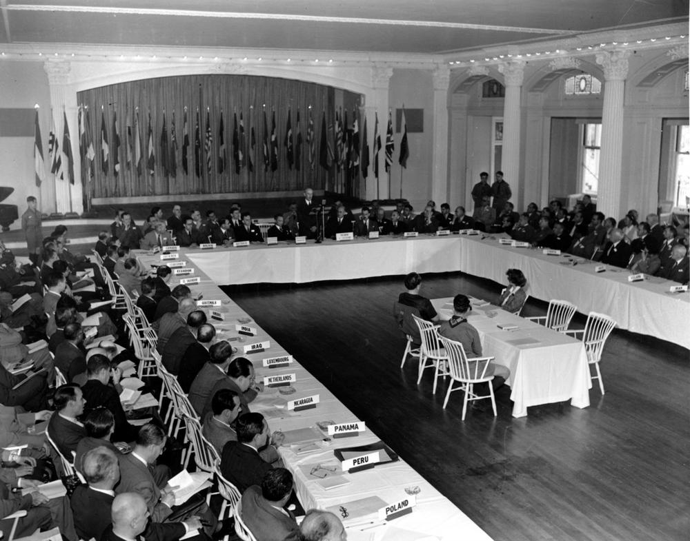 This is a general view of a plenary session of the United Nations Monetary Conference in Bretton Woods, N.H. on July 4, 1944. Delegates from 44 countries are seated at the long tables. Sen. Charles W. Tobey, R-NH, is speaker in center background. (AP Photo/Abe Fox)