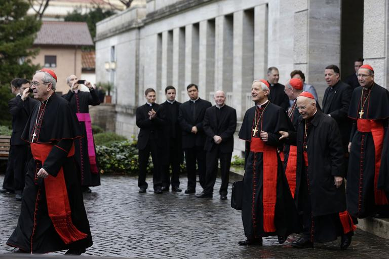From left, US Cardinals Justin Francis Rigali, Donald Wuerl, Timothy Dolan, Francis George and Roger Mahony leave the North American College to go to the Vatican's Domus Sanctae Martae, the Vatican hotel where the cardinals stay during the conclave, in Rome, Tuesday March 12, 2013. (AP)