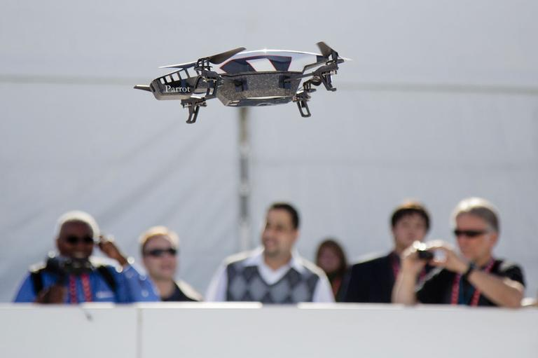 A Parrot AR Drone 2.0 is seen flying during a demonstration at the Consumer Electronics Show, Wednesday, Jan. 9, 2013, in Las Vegas. The drone has a built in camera and can be controlled with a smart phone. (AP)