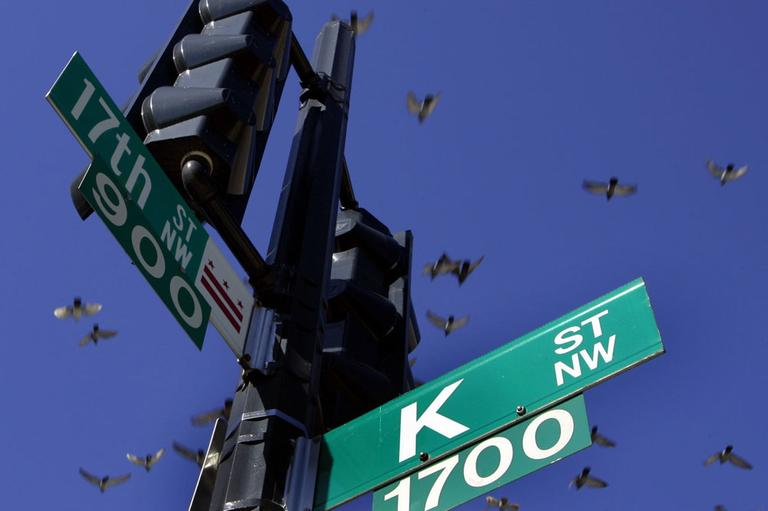 In this Jan. 26, 2006, file photo pigeons fly over the intersection of 17th and K streets in northwest Washington Thursday, Jan. 26, 2006. K Street has long been invoked as shorthand for moneyed lobbyists who ply influence in the city. (AP)
