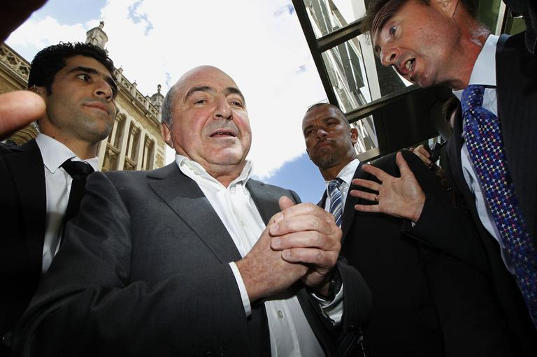 Russian tycoon Boris Berezovsky, second from left, talks to a reporter after losing his case against Russian oligarch Roman Abramovich as he leaves the High Court in London, Friday, Aug. 31, 2012. (AP)