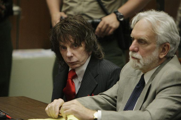 Music producer Phil Spector, left, and his attorney Dennis Riordan appear in a courtroom for Spector's sentencing in Los Angeles, Friday, May 29, 2009. (AP)