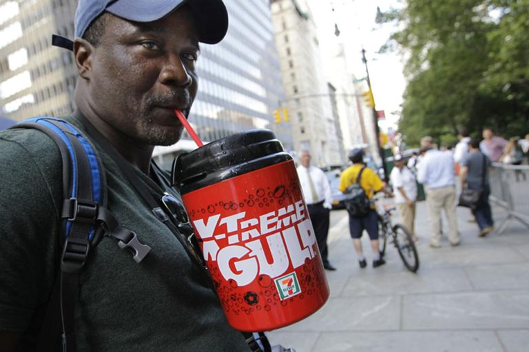 In this July 9, 2012 file photo, protester Eric Moore sips on an extra-large beverage during a protest against Mayor Michael Bloomberg's proposal to prohibit licensed food establishments from using containers larger than 16 ounces to serve high-calorie drinks at City Hall in New York. (AP)
