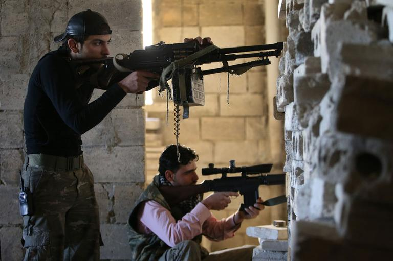 Free Syrian Army fighters, take their positions as they observe the Syrian army forces base of Wadi al-Deif, at the front line of Maarat al-Nuaman town, in Idlib province, Syria, Tuesday Feb. 26, 2013. (AP)