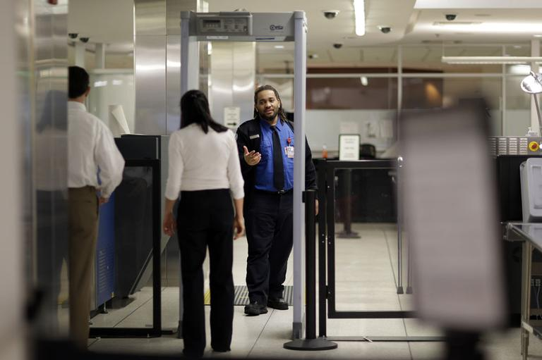 A Transportation Security Administration officer directs a traveler to step through a metal detector at a security checkpoint at Baltimore-Washington International Thurgood Marshall Airport in Linthicum, Md., Friday March, 1, 2013. (AP)