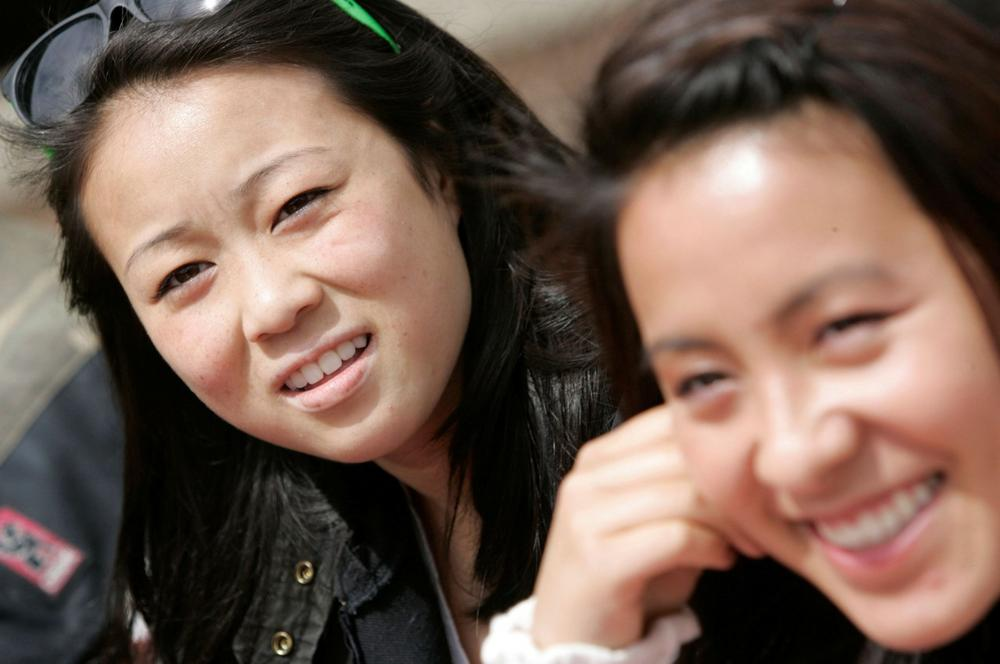Jessica Peng, left, and Lauren Sit talk about proposed college admissions guidelines affecting Asian students at Lowell High School in San Francisco, Thursday, April 23, 2009. (AP)