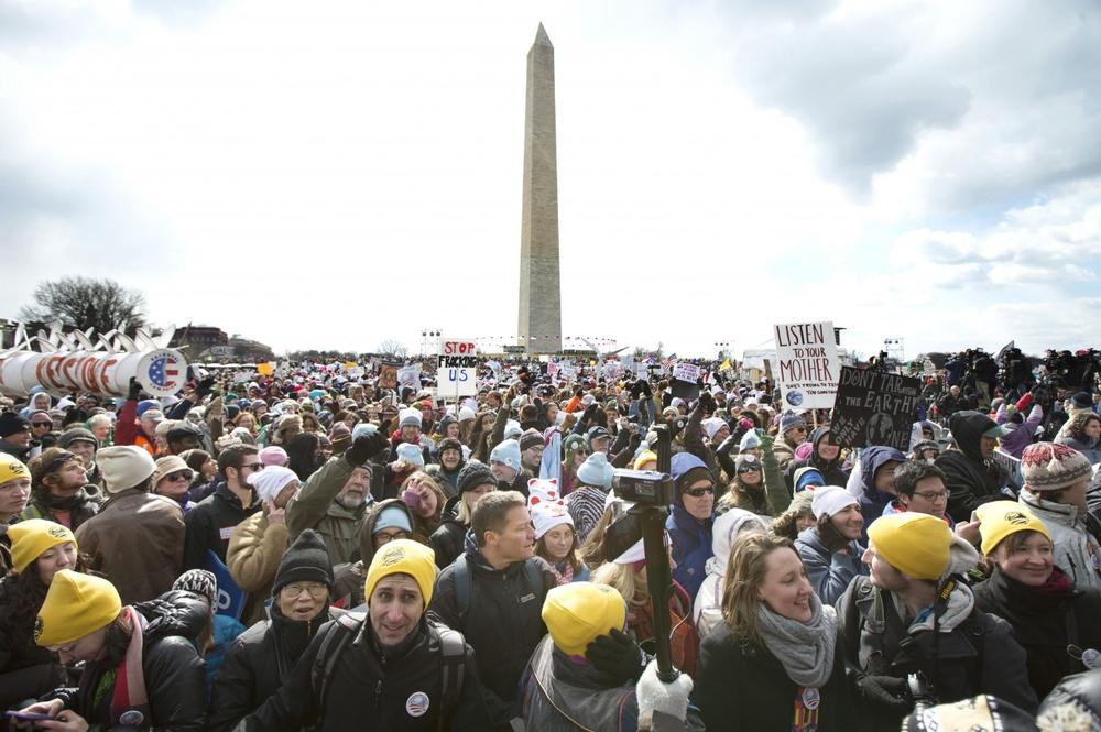 "Thousands of protestors gather at the National Mall in Washington calling on President Barack Obama to reject the Keystone XL oil pipeline from Canada, as well as act to limit carbon pollution from power plants and ""move beyond"" coal and natural gas, Sunday, Feb. 17, 2013. (AP)"