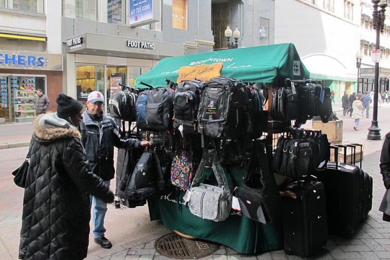 Craig Kaplan is one of many push-cart vendors at Downtown Crossing. (Ava Aguado/WBUR)