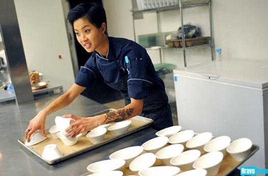 Kristen Kish starts plating one of her dishes on the show Top Chef. (Bravo)