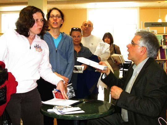 Stephen Puleo autographs books at Bestsellers Cafe.  (John Harrison)