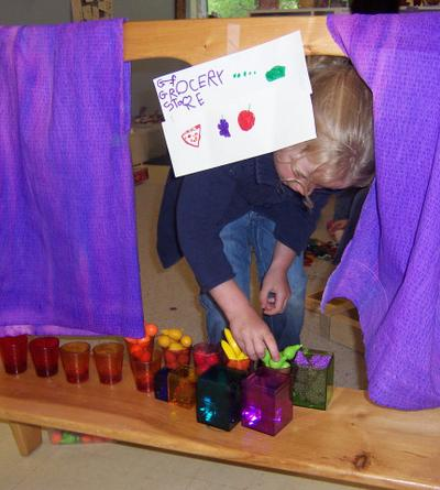 In this photo, a pre-K student plays grocery store. The author says this kind of pretend play requires more cognitive complexity than learning isolated skills. (Courtesy)