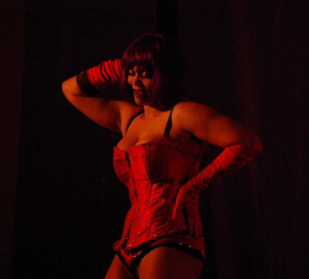 "Cherokee Rose, who won the prize for ""most classic"" dancer at the 2012 ""Great Burlesque Exposition,"" performs at the opening of this year's conference. (Greg Cook)"