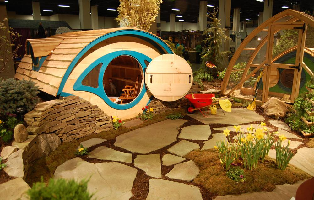 New England Nurseries of Bedford proposes inspiring love of the outdoors and gardening among children by placing this eye-shaped playhouse near a garden and chicken coop. (Greg Cook)