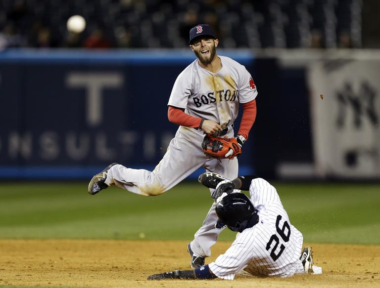 Dustin Pedroia throws to first after New York Yankees' Francisco Cervelli, not shown, grounded out.  (AP)