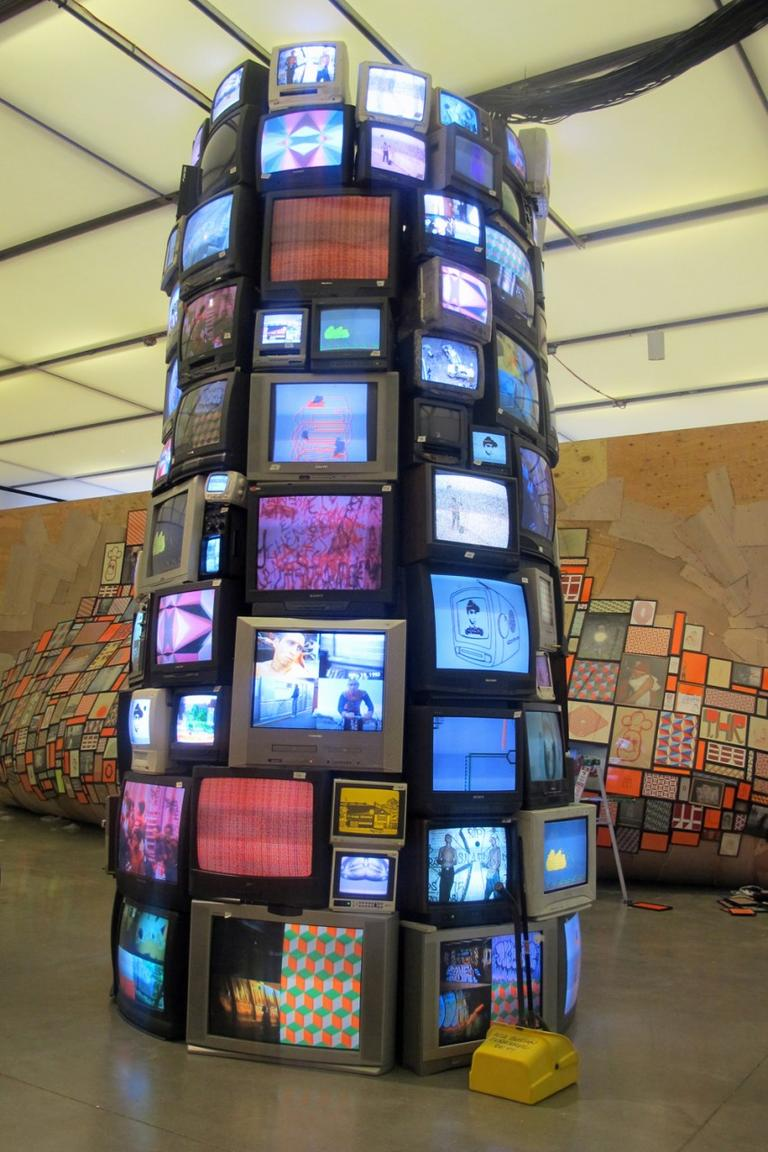 McGee and Josh Laczano created this tower after stockpiling discarded sets as most people switched from old-format televisions to flat screens. (Andrea Shea/WBUR)