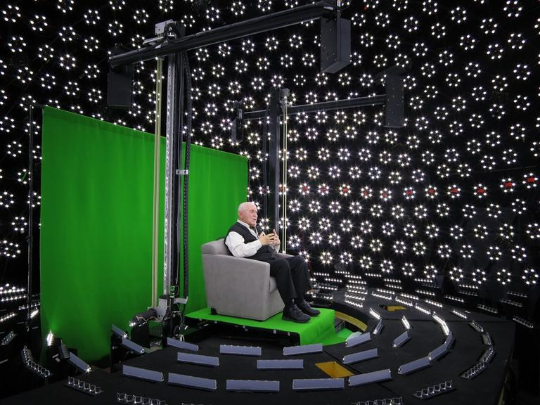 Pinchas Gutter answers questions about his life on an ICT light stage surrounded by high-speed cameras and LED lights (click to enlarge). (Paul Debevec/USC Institute for Creative Technologies)