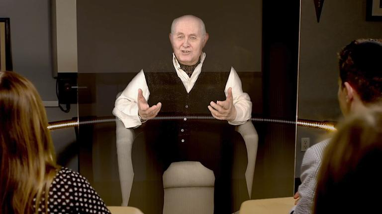 A hologram of Holocaust survivor Pinchas Gutter interacts with onlookers during a demonstration of the New Dimensions in Technology project. (USC Institute for Creative Technologies)