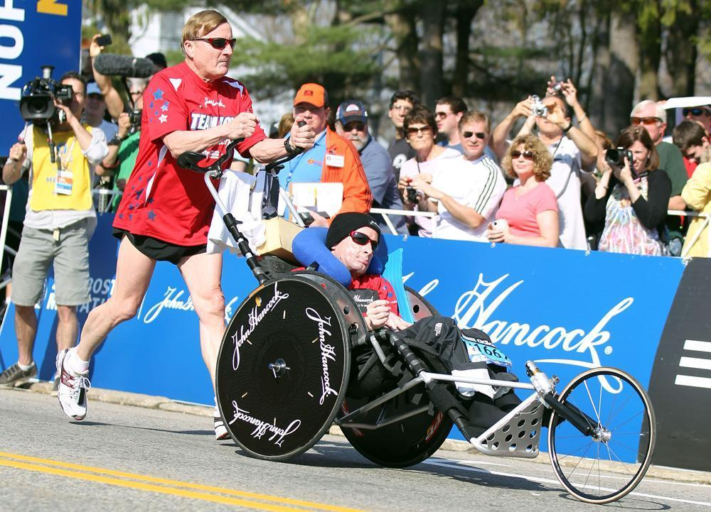 Dick Hoyt, left, and his son, Rick, start the 116th running of the Boston Marathon in Hopkinton, April 16, 2012. (Stew Milne/AP)