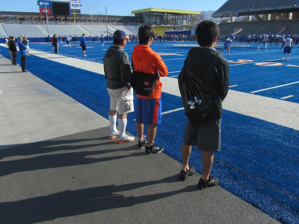 Head Coach Hitoshi Aoki (left) watches a recent Boise State practice with players Aro Kondo (middle) and Eiichi Rokukawa. (Scott Graf/Only A Game)