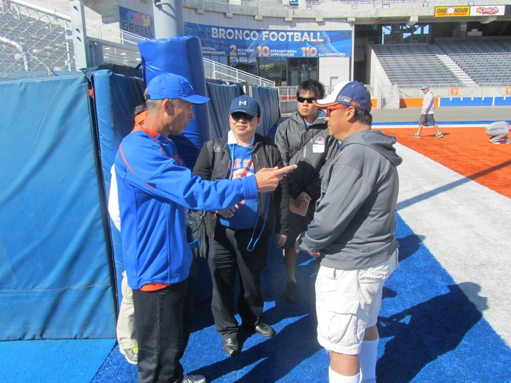 Boise State head coach Chris Petersen talks with Hosei University representatives. (Scott Graf/Only A Game)