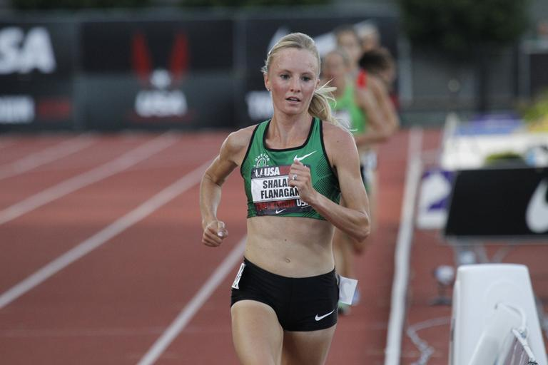 Distance runner Shalane Flanagan races during the 10,000 meter race in the U.S. track and field championships in Eugene, Ore., June, 23, 2011. Flanagan won with a time of 30 minutes, 59.97 seconds.(Don Ryan/AP)