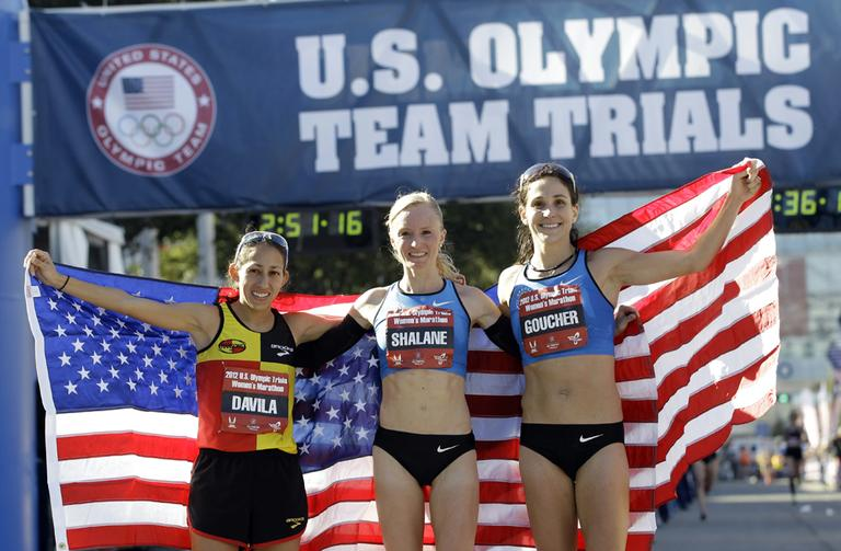 The top three women finishers, from left, Desiree Davila, second, Shalane Flanagan, first, and Kara Goucher, second, pose after running in the U.S. Olympic Trials Marathon, Jan. 14, 2012, in Houston. (David J. Phillip/AP)