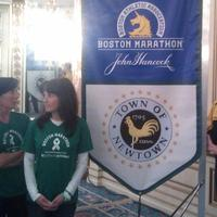 "A group of parents from Newtown, Conn. are running the marathon in memory of the 26 people killed in the mass shooting there in December. Laura Nowacki (far right) says ""We're all parents. We're Sandy Hook parents. We're also runners and we are here to run 26 miles for 26 lives."" (Alex Ashlock/Here & Now)"