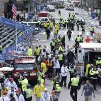 Medical workers aid injured people at the finish line of the 2013 Boston Marathon following an explosion in Boston, Monday, April 15, 2013. (Charles Krupa/AP)