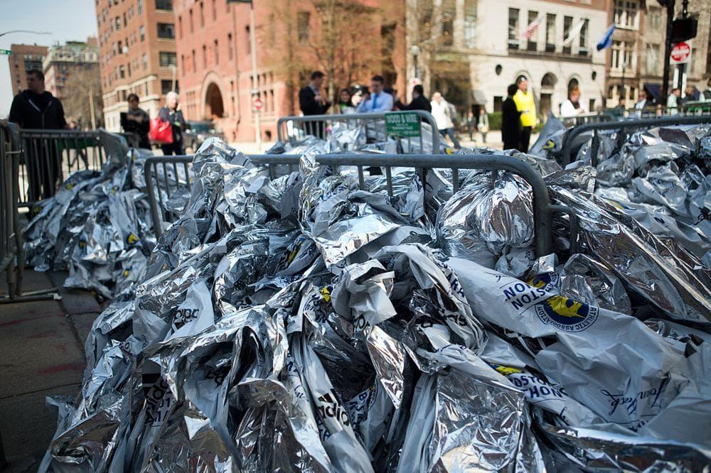 Boston Marathon polyethylene heatsheets piled up at Clarendon and Newbury Streets. (Jesse Costa/WBUR)