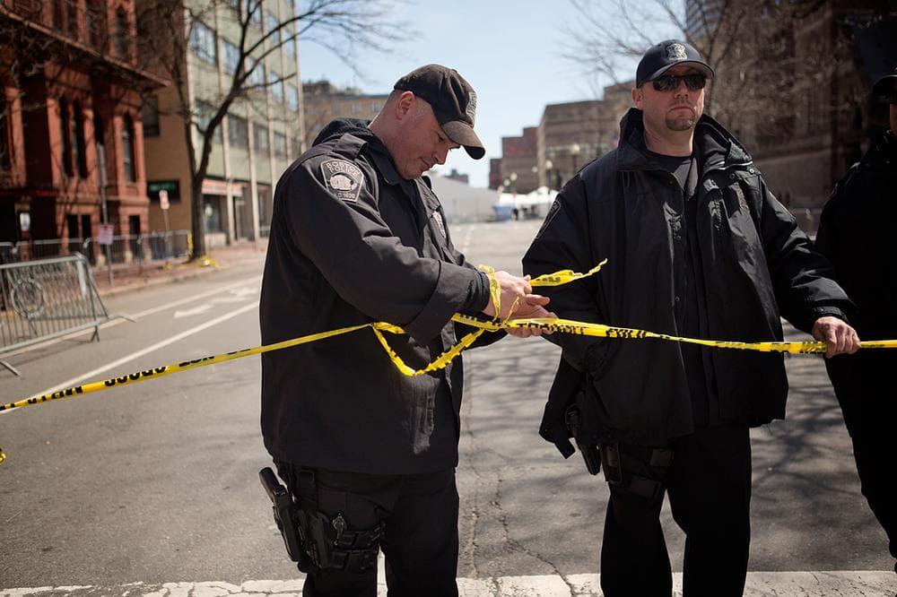 Boston Police set up yellow tape across Dartmouth St. (Jesse Costa/WBUR)