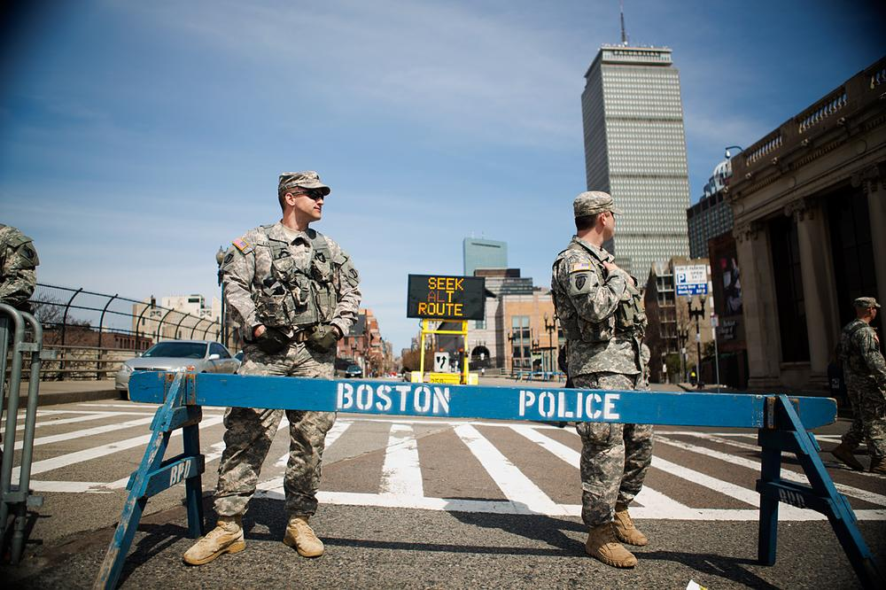 Army National Guardsmen standing at Mass Ave and Boylston St. (Jesse Costa/WBUR)