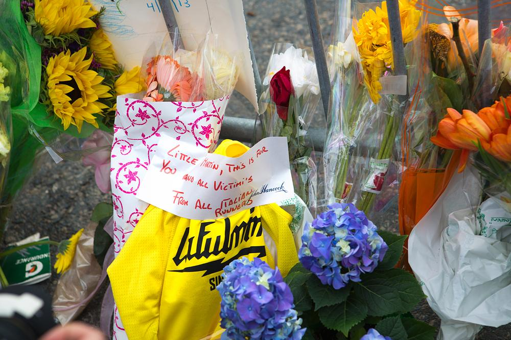 Close up of Memorial set up on Clarendon and Boylston Streets after police and opened the barricade at Berkley St. (Jesse Costa/WBUR)