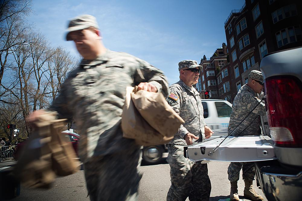 Army National Guardsmen unload packed lunches for security personnel working on and around the Boylston Street crime scene. (Jesse Costa/WBUR)