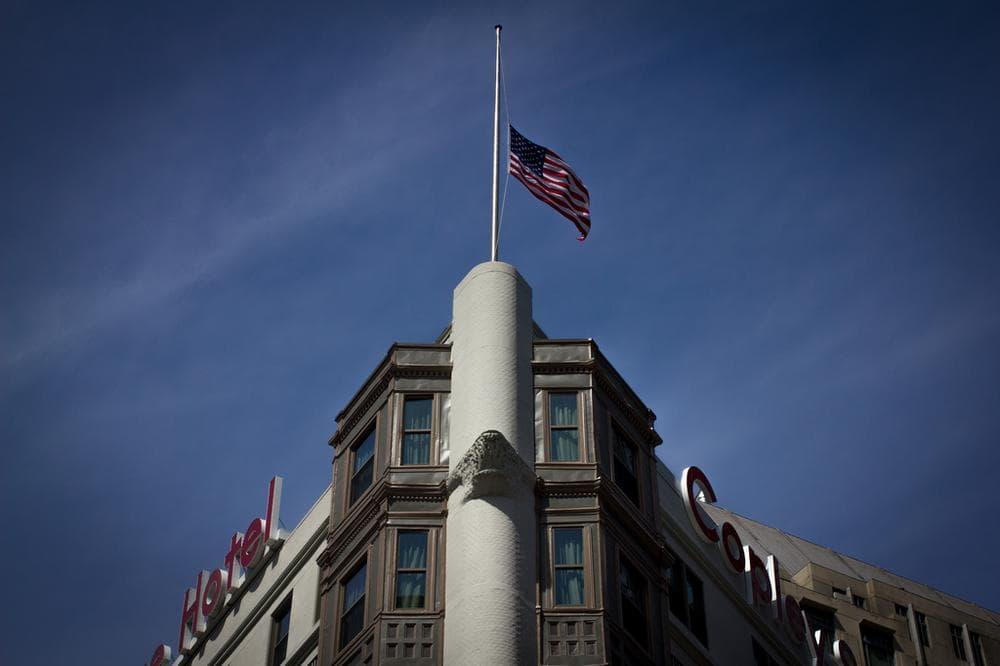 Flag at half-mast on the Copley Square Hotel. (Joe Spurr/WBUR)