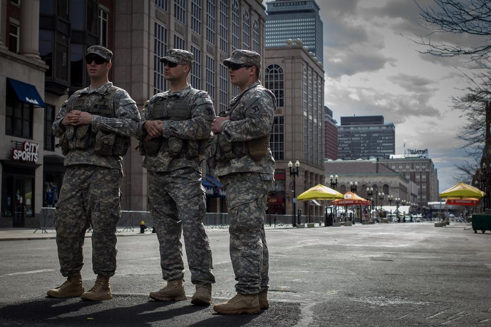 Army National Guardsmen standing at the blockade at Berkeley and Boylston Streets. (Joe Spurr/WBUR)
