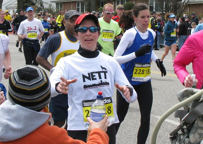 Karyn Miller-Medzon takes water from her son Noah at mile 17 of the Boston Marathon. (Medzon family photo)