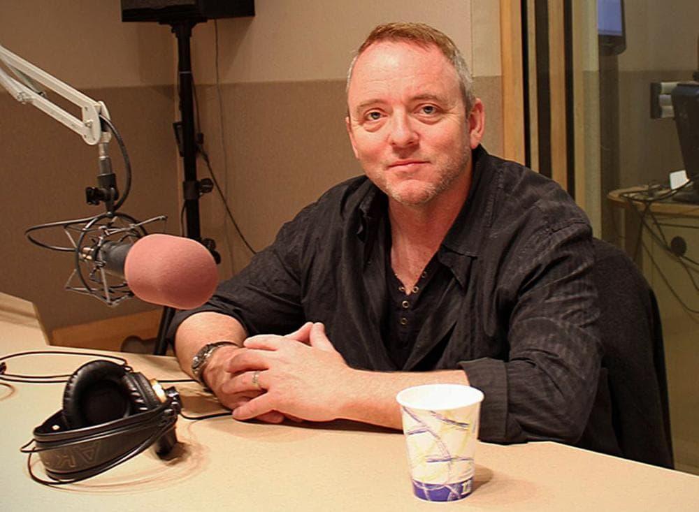 Author Dennis Lehane in the On Point studio with Tom Ashbrook on April 18, 2013. (Alex Kingsbury/WBUR)
