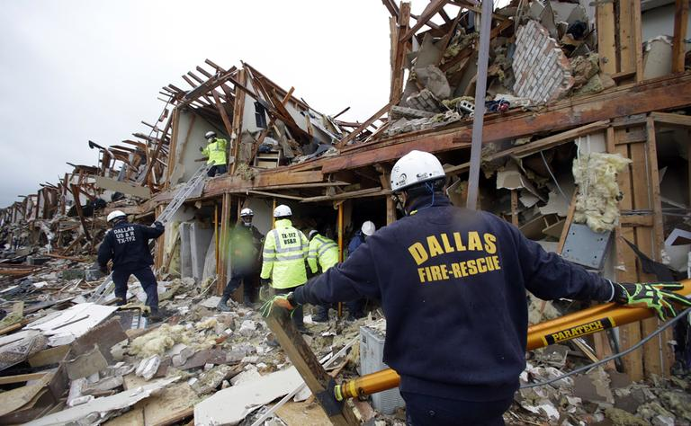 Firefighters conduct search and rescue of an apartment destroyed by an explosion at a fertilizer plant in West, Texas, Thursday, April 18, 2013. (LM Otero/AP)