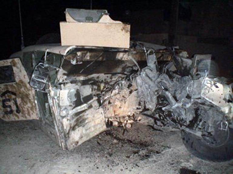 This photo provided by Tom Davis shows the results of an IED that struck his humvee in 2006. (Tom Davis via AP)