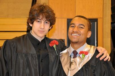 Dzhokhar A. Tsarnaev (left) and Here & Now host Robin Young's nephew Zolan (right) are pictured in a Cambridge Rindge and Latin graduation photo. Tsarnaev has been identified as the surviving suspect in the marathon bombings. (Courtesy: Robin Young)
